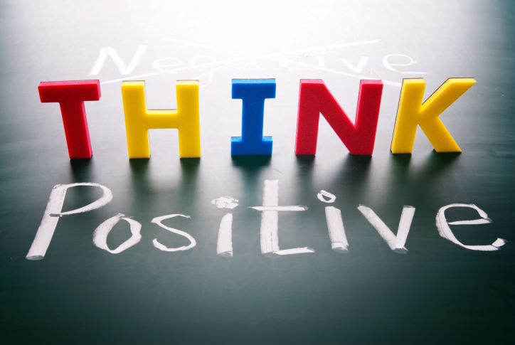 THINK POSITIVE in block letters related to getting motivated to clean